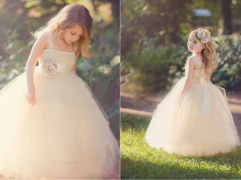 Floor length custom flower girl dress. Blush tulle puffy ball gown skirt adds dimension for a stunning look. Sleeveless spaghetti strap bodice features gathered details neckline and delicate flower at ribbon adorning on empire waist and perfectly tied at back,FG852